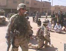 CNN Video Frame of Lt. Col. Chris Hughes and men