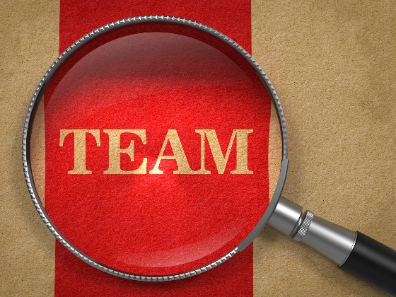 Team - Magnifying Glass on Old Paper..