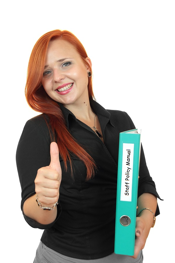 Staff Member with Staff Policy Manual