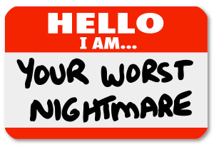 A blue nametag sticker with words Hello I Am Your Worst Nightmar